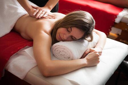 rubdown: Beautiful woman having a massage Stock Photo