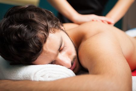 laying on back: Man having a massage in a spa