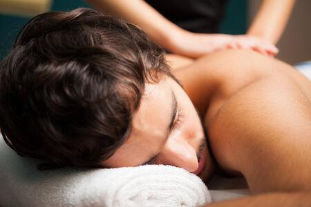 rubdown: Man having a massage in a spa