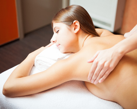 rubdown: Young woman getting a massage in a spa
