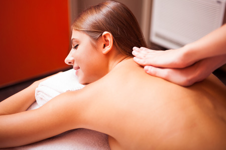 rubdown: Young woman having a massage in a spa
