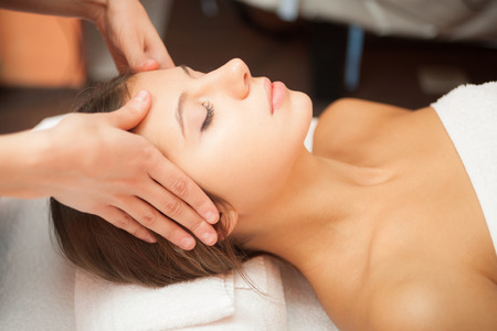 Beautiful woman having a facial massage Stock Photo