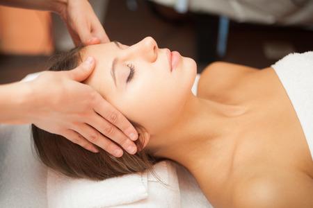 facial massage: Beautiful woman having a facial massage Stock Photo