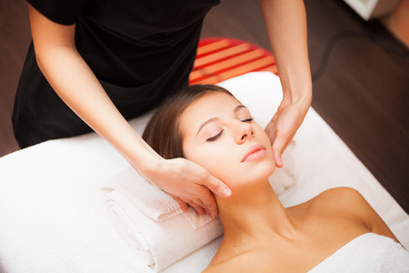 Beautiful woman receiving a facial massage Stock Photo