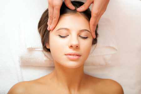 tuina: Beautiful woman having an head massage