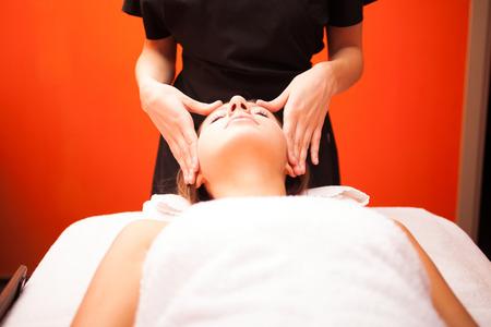 Beautiful woman having an head massage photo