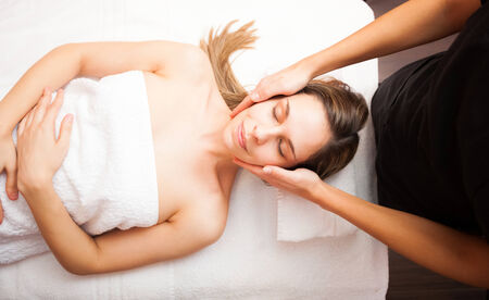rubdown: Beautiful woman having a facial massage Stock Photo