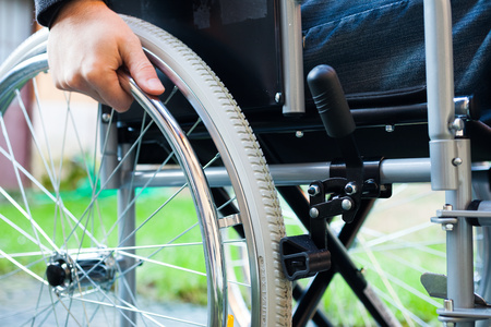 wheelchair access: Paralyzed man using his wheelchair Stock Photo
