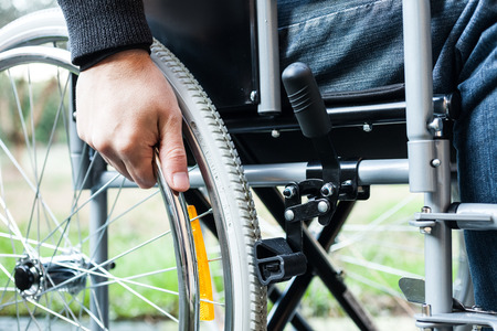 Paralyzed man using his wheelchair photo