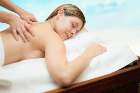 lymphatic drainage therapy: Relaxed woman receiving a massage