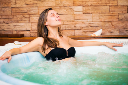 hydromassage: Beautiful woman relaxing in a whirlpool