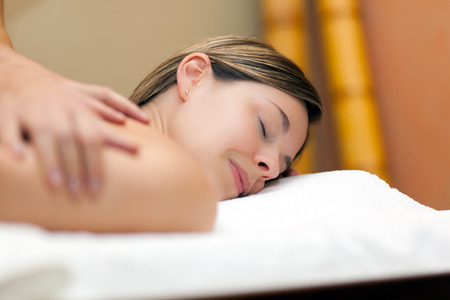 chiropractic: Woman having a massage in a spa
