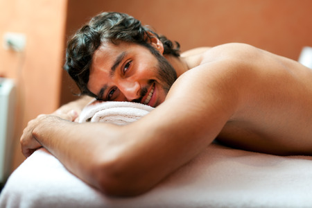 rubdown: Handsome man in a spa Stock Photo