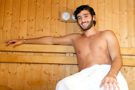 Man relaxing in a sauna photo