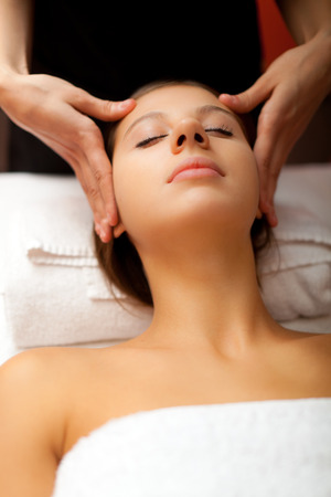 Woman having a massage in a spa photo