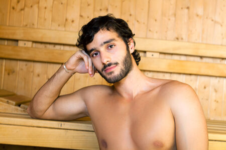 Portrait of a man relaxing in a sauna photo