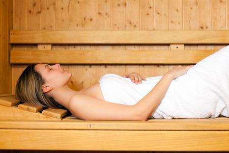 sauna: Woman relaxing in a sauna Stock Photo