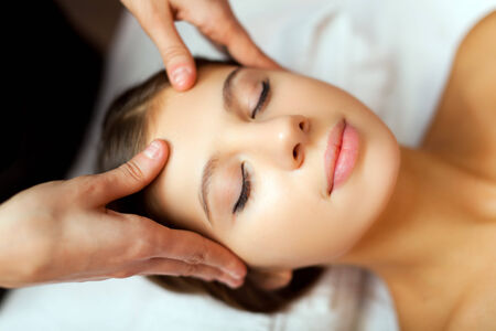 swedish: Woman relaxing while having a massage Stock Photo