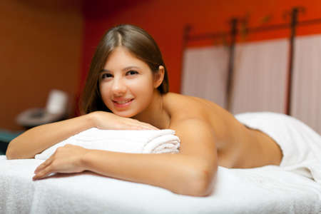 rubdown: Woman relaxing while having a massage Stock Photo