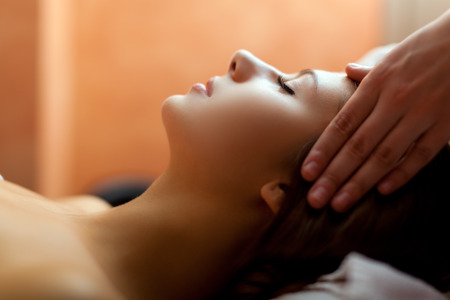 Woman relaxing while having a massage Stock Photo