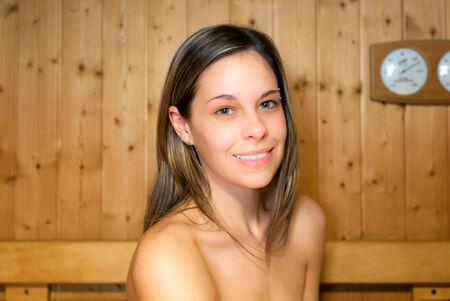 finnish bath: Woman relaxing in a sauna Stock Photo
