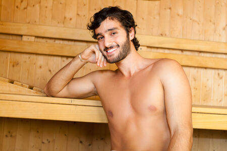 Handsome mai relaxing in a sauna photo