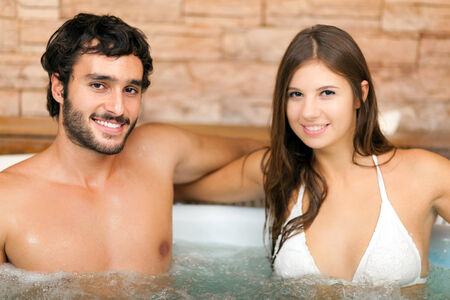 hydromassage: Couple in a swimming pool in a spa