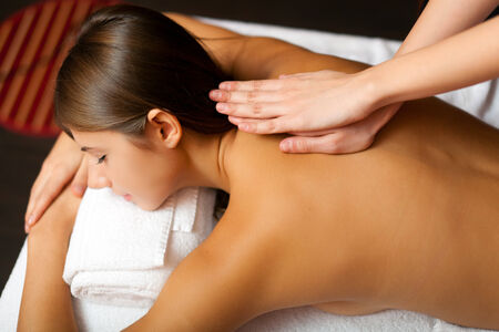 rubdown: Young woman receiving a massage in a spa