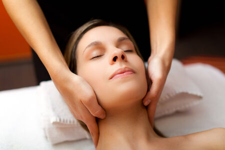 rubdown: Woman receiving a massage in a spa Stock Photo