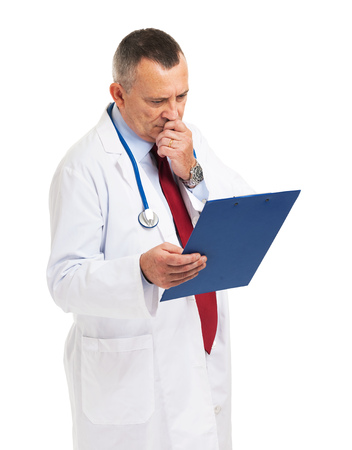 Senior doctor reading a case history photo