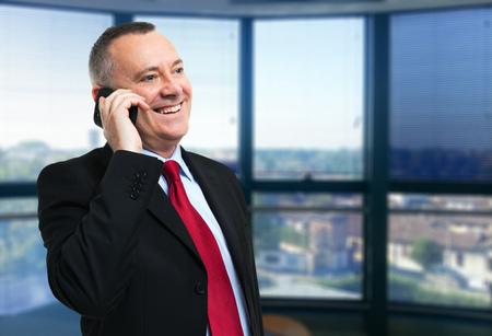 Executive talking on the phone photo
