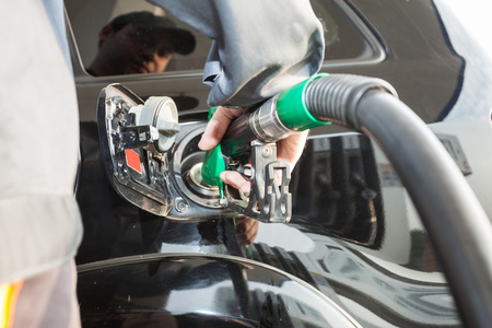 normal distribution: Man fueling a car Stock Photo
