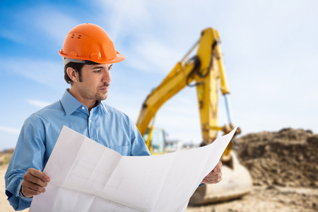 gaffer: Portrait of an architect at work in a construction site Stock Photo