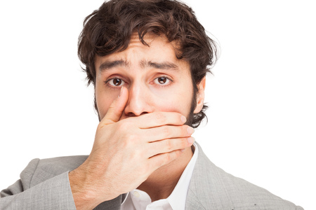 shut: Man shutting his mouth  Isolated on white Stock Photo