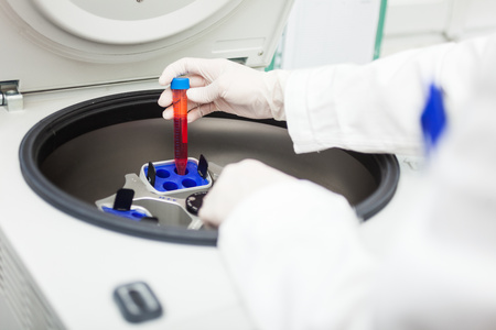 centrifuge: Detail of a scientist using a laboratory centrifuge Stock Photo