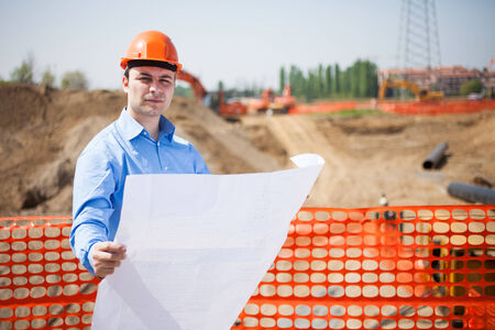 architecture plans: Portrait of an engineer in a construction site Stock Photo