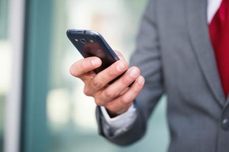 Close up of a man using mobile phone Standard-Bild