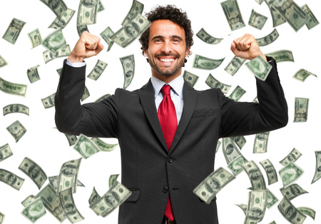 cash money: Hombre feliz disfrutando de la lluvia de dinero Foto de archivo