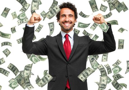 pieniądze: Szczęśliwy człowiek korzystających z deszczu pieniędzy Zdjęcie Seryjne