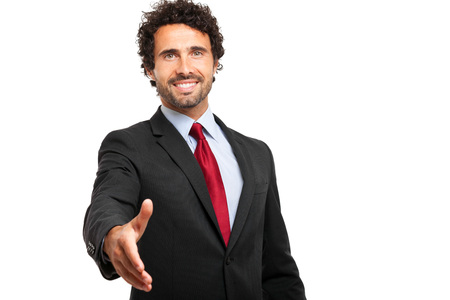 Businessman giving his hand isolated on white photo