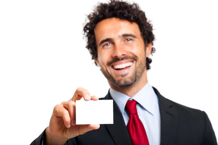 Business man handing a blank business card isolated photo