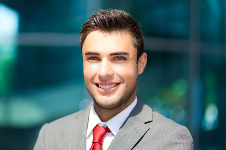 Confident smiling business man outdoor photo