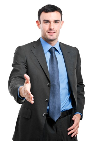 Businessman giving his hand on white background photo