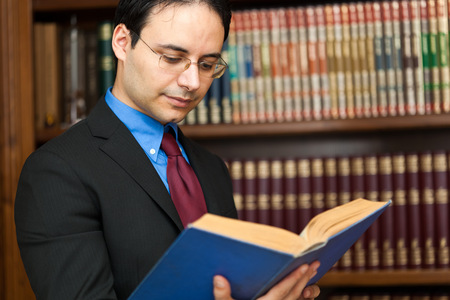 Handsome lawyer reading a book
