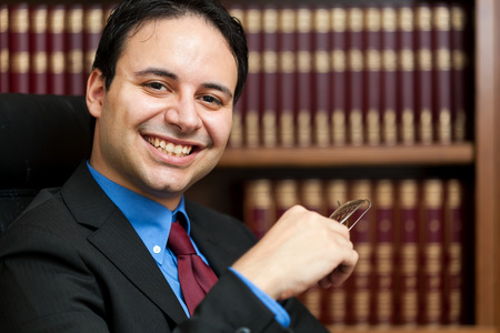 principal: Smiling lawyer portrait in his studio