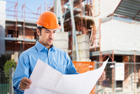 Portrait of an architect at work in a construction site Standard-Bild