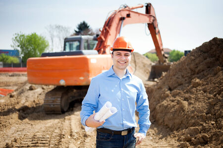 construction management: Smiling architect in a construction site