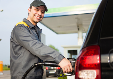 Smiling gas station attendant at work