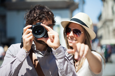 Tourists photographing and having fun in a city photo