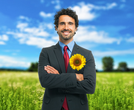 Business and ecology concept, businessman keeping a sunflower in his pocket photo